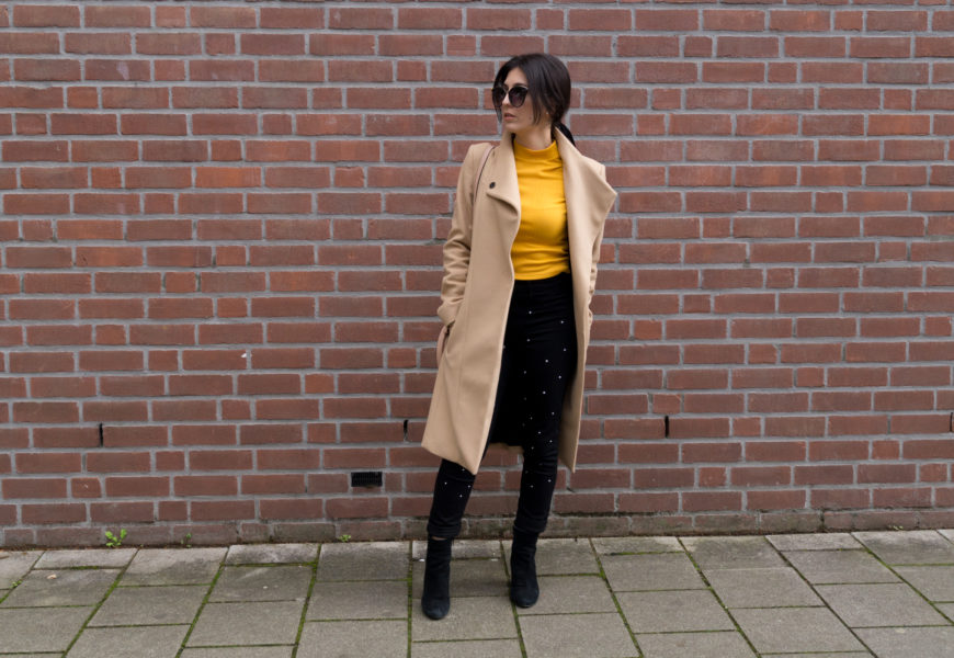 Mustard top with black pearled jeans