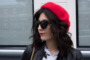 Red beret with a black & white outfit