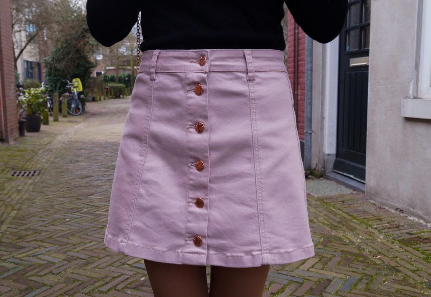 Pink button-front denim mini skirt