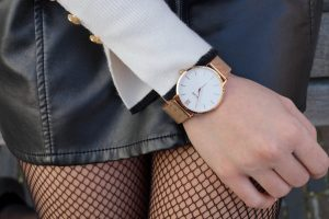 Fishnet tights with faux leather skirt