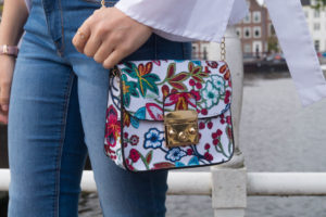 Floral print bag and white top