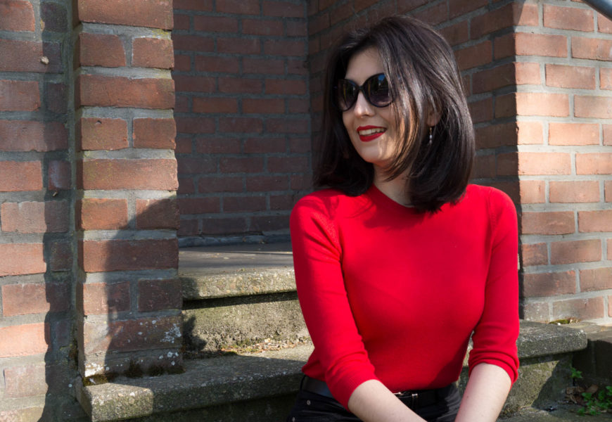 Red knitwear top with pearls